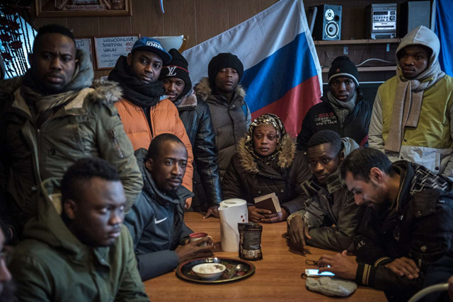 Migrants from African counties in a hostel in Kandalaksha, waiting to cross into Finland, 2 April 2016. The flow of refugees and migrants on the Arctic route has added a hefty dose of geopolitical anxiety. Photo: Sergey Ponomarev / The New York Times