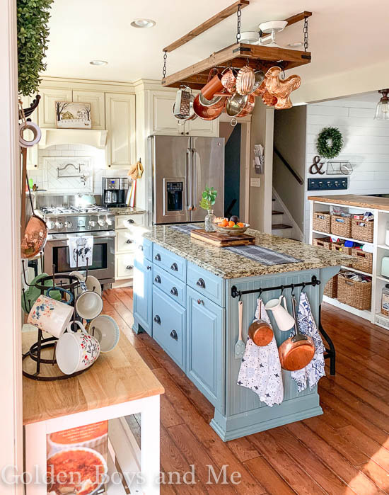 Farmhouse style kitchen with painted kitchen island with Oval Room Blue paint - www.goldenboysandme.com