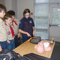 EMT Heidi demonstrates defibrillator