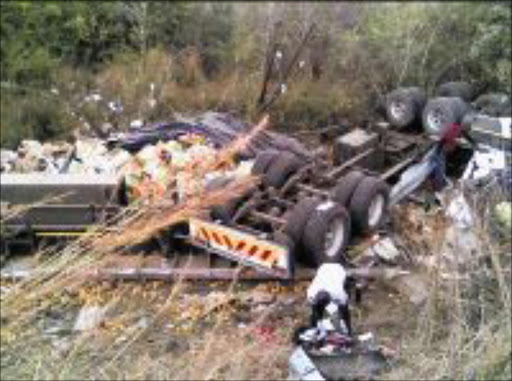 WRECKAGE: Oranges are spilled from a truck that rolled down a steep road at Bushbuckridge in Mpumalanga on Friday. Pic: Riot Hlatshwayo. 02/08/2009. © Sowetan.