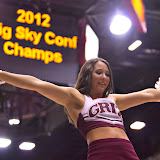 Spirit Squad member Keiko Sagami is launched into the air during a partner stunt shortly before the commencement of the Montana Grizzly 2012-13 men's basketball season.  Photo by Austin Smith