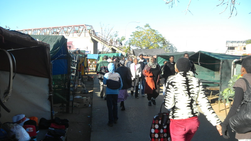 The vendors near the bus rank