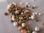 A batch of copper, bronze and green beads.