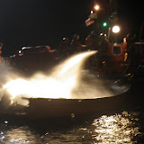 14 September 2012 - fire crew douse the flames using the hose on the all-weather lifeboat.  Photo credit: RNLI/Poole