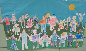 A kindergarten's class group of self-portraits.
