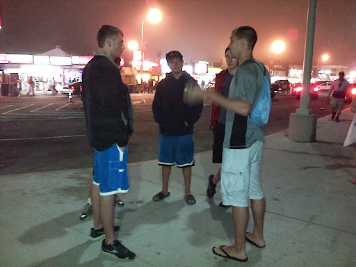 One of the team members is having a fruitful follow-up discussion after an open-air message!