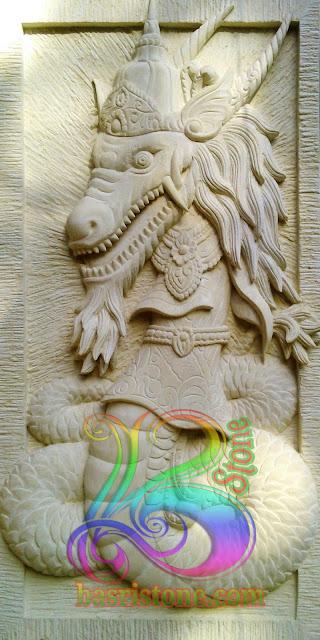 Relief batu alam motif gambar nagasasra untuk hiasan dinding