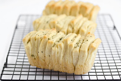 photo of three mini pull apart breads on a baking rack