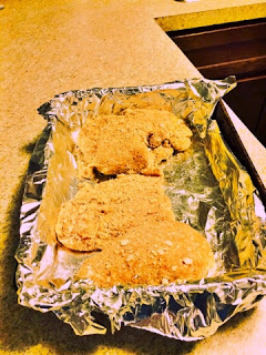 Place breaded chicken into foil lined pan