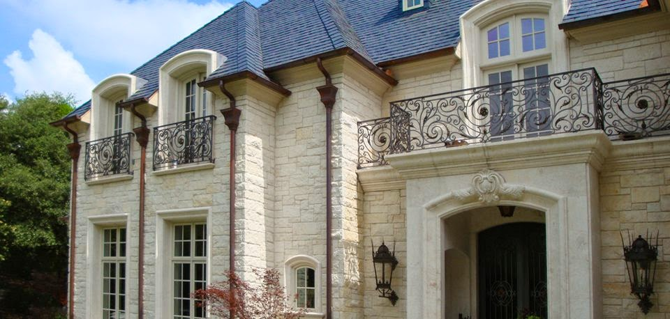 front wrought iron balconies and lanterns