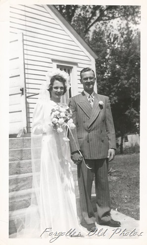 Couple outside church 1940s DL ant