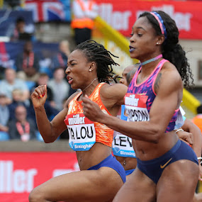 Pushing through. by Ron Russell - Sports & Fitness Running ( ladies, athletics, racing, track, determination, sprint, running )