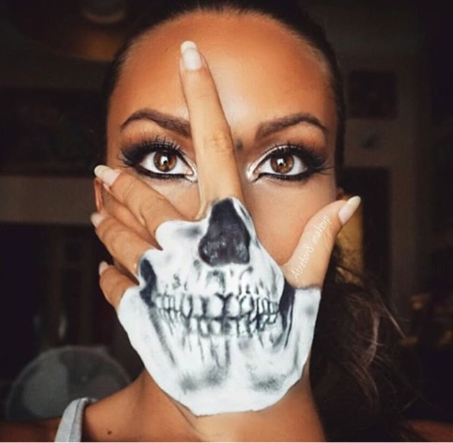 skele hand this look is great because your face is done as if its a normal day also you can still wear lipstick and just put your hand over your mouth