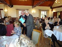 44th Charter Lunch  12th October 2014 Cumberwell Park Golf Club. Ron Plum receiving his 10 year chevron.  Chris Penny, MJF, our last Charter Member also received a 45 year chevron from District Governor Mike Hendy.