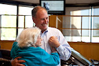 Music makes a lot of people want to move. Julianne's uncle Terry Hough, a Carrollton sales consultant at Park Place Lexus Grapevine, dances with 93-year-old Grace Burton of Plano.