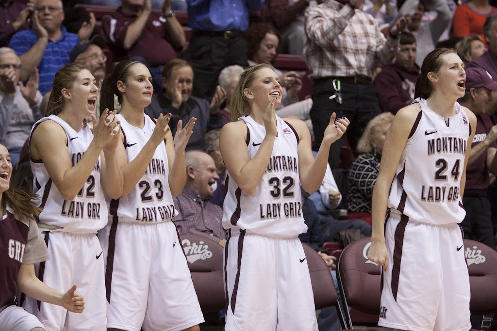 McCalle Feller, left, Kellie Cole, Alexandra Hurley, Maggie Rickman, and Carly Selvig cheer for Kenzie De Boer from the bench Thursday evening.  Dahlberg Arena in Missoula, Mont., December 6th, 2012.