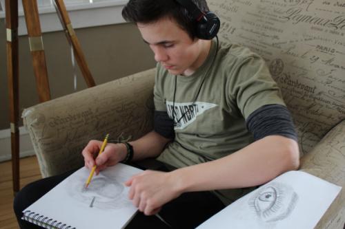 high schooler doing art