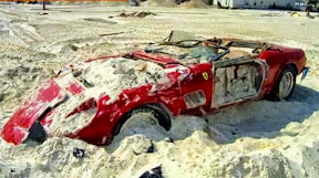 Recovered Ferrari 250 GTO dugged up in the sand