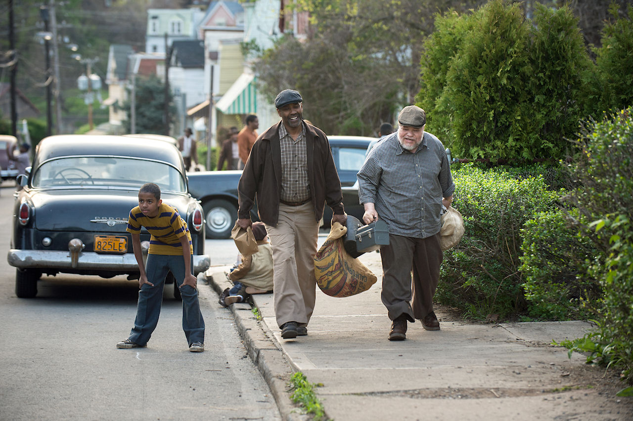 Denzel Washington plays Troy Maxson and Stephen McKinley Henderson plays Jim Bono in FENCES. (Photo courtesy of Paramount Pictures).