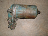 1953-1958 264-322-364 oil filter housing, stock type. Call