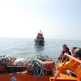 Crew members discussing the tow of a Severn class lifeboat during training