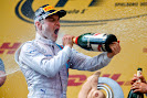Valterri Bottas sprays himself with Champagne on his first F1 podium