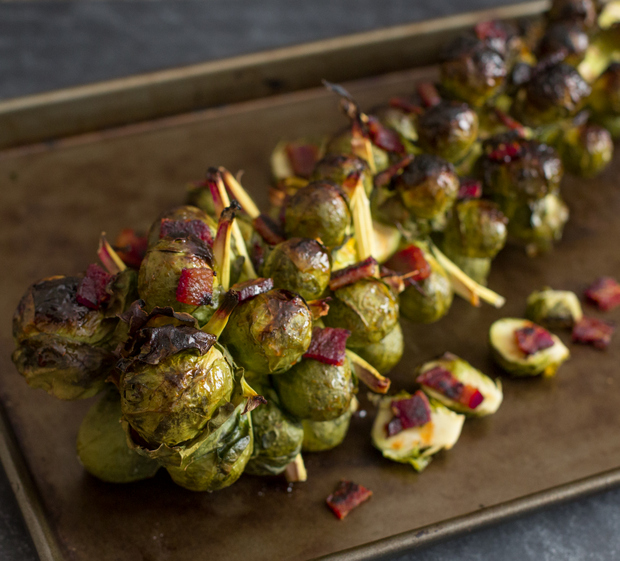 close-up photo of Bacon Honey Sriracha Brussels Sprouts on the Stalk