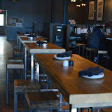 Similar to many of the newly added light fixtures, tables and stools at the are a blend of iron and wood--they look old, but are new and hip--and easily moved when the venue provides for larger bands and entertainers.