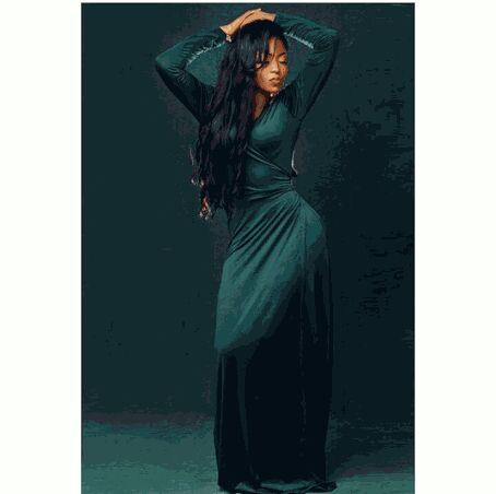 Debbie Rise shows Curves in Green Gown
