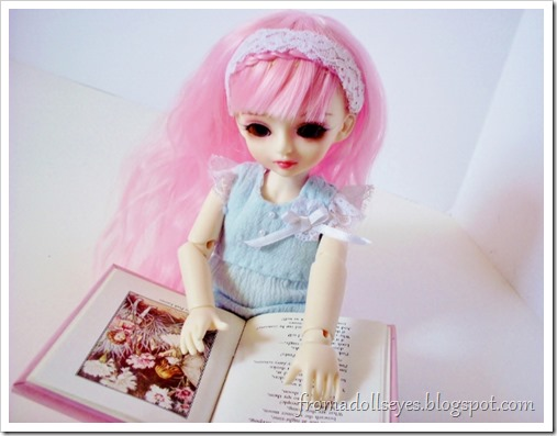 A doll learning to read.  Reading is for Everyone.