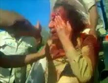 مصور يحكي اللحظة الأخيرة من حياة القذافي