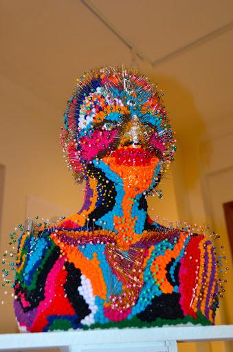 Natasha Kroupensky art. From Go Eat Give combines travel, food, and volunteering