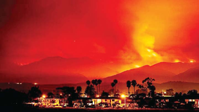 Smoke is illuminated blazing orange by the Whittier wildfire near Santa Ynez, California as a record-setting heat wave ravaged the United States state 8 July 2017. Photo: Reuters