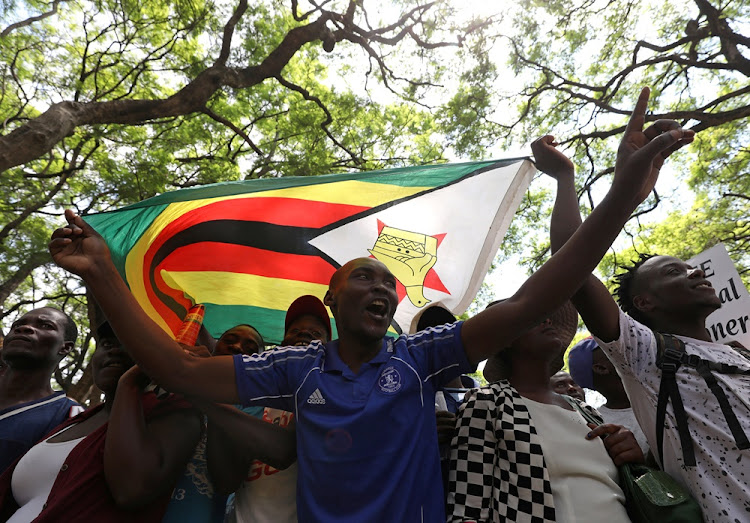 Protesters call for Zimbabwean President Robert Mugabe to resign across the road from parliament in Harare, Zimbabwe, November 21, 2017.