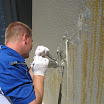 A technician pumps the material into the crack.