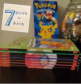 Stack of Pokémon books in front of a Pokémon VHS
