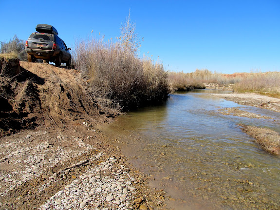 Jeep on the south side of the San Rafael River at Fuller Bottom