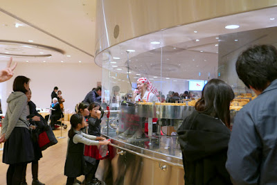 Momofuku Ando Instant Ramen Museum - Here at the My Cupnoodles Factory, you can create your own completely original CUPNOODLES package. By putting the cup upside down onto the noodles, the noodles don't get stuck when you drop into the cup and mess up the assembly line.
