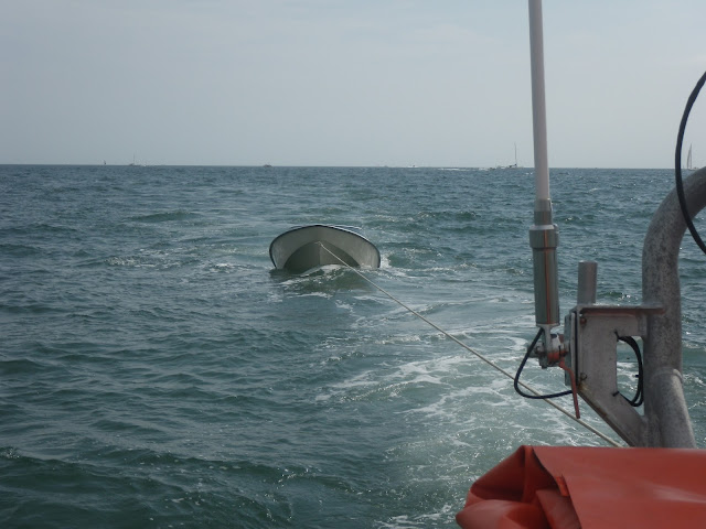 1 September 2012 - a motorboat is towed by the ILB.  Photo credit: Poole RNLI/Dave Riley