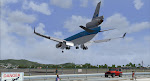 KLM MD-11 soars past Maho Beach as she arrives from Amsterdam.