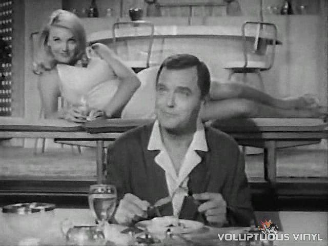 Barbara Bouchet laying sexy behind Gig Young in The Rogues
