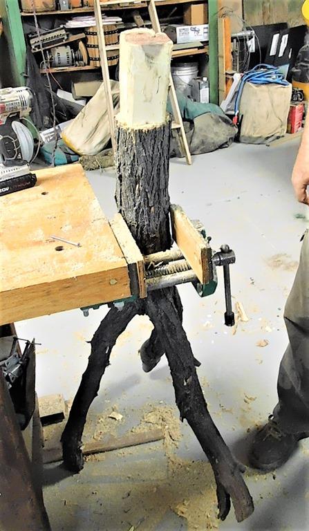 cut tree limb to fit base
