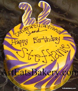 Custom unique Clemson orange and purple tiger striped birthday cake with 22 topper