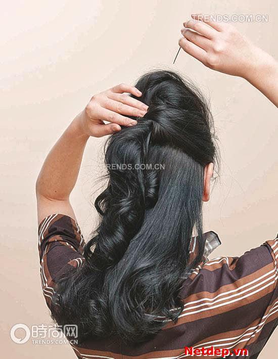 Kiêu sa với kiểu tóc chim công