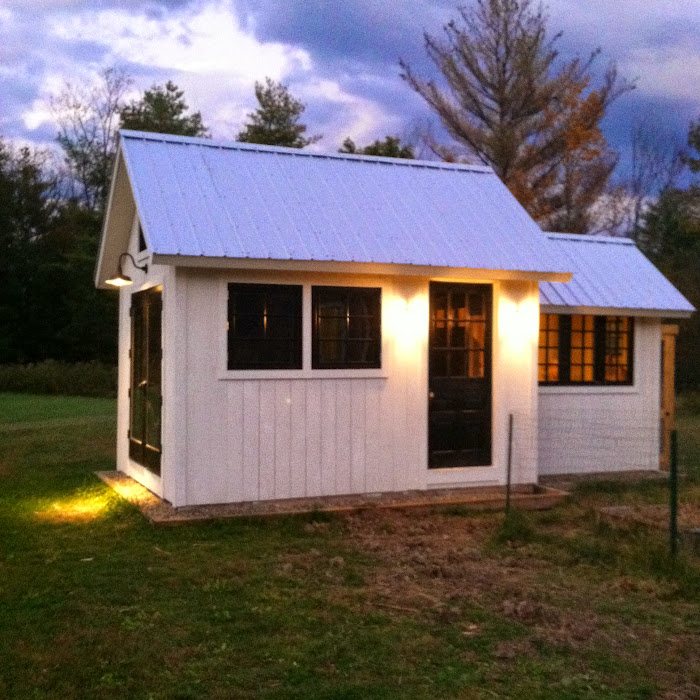 Shed lit up at dusk