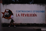 Slogans like this adorn walls in towns throughout Cuba