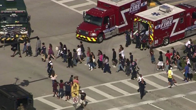 Students are evacuated from Marjory Stoneman Douglas High School during a shooting incident in Parkland, Florida, 14 February 2018 in a still image from video. Photo: WSVN.com / Reuters