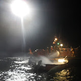 14 September 2012 - Poole RNLI all-weather lifeboat putting out the fire by Fisherman's Quay.  Photo credit: RNLI/Poole