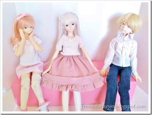 Hikaru is sitting between Yuki and Usagi who both look amazed at the size of the skirt.  They have to sit farther away to make room.