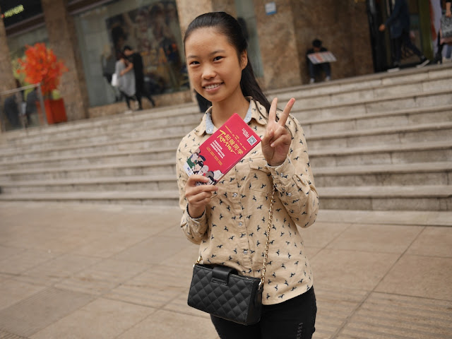 female college student handing out leaflets in Changsha